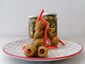 Green pitted, red pepper - stuffed olives
