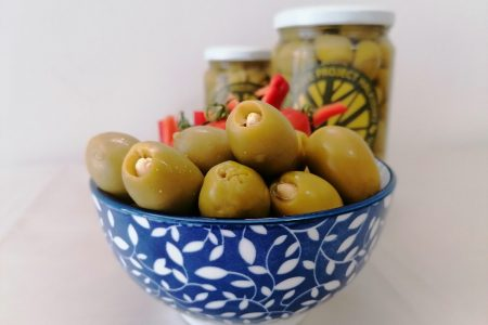 Green pitted almond - stuffed olives